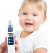 Thermometer displaying 36,6 Celsius degrees on defocused happy k