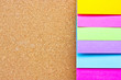 Six colorful sticky notes on wooden board.