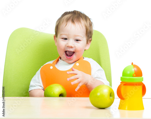 attractive child eating apples, isolated on white