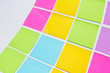 Colorful sticky notes on white background.
