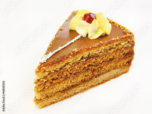 Triangular cake with decorative flower