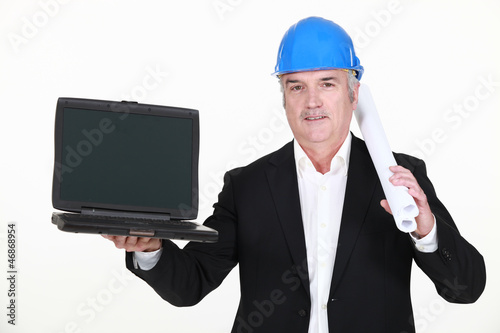 A mature architect with a laptop.