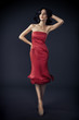 Beautiful Woman In Res Rose Dress On Dark Background