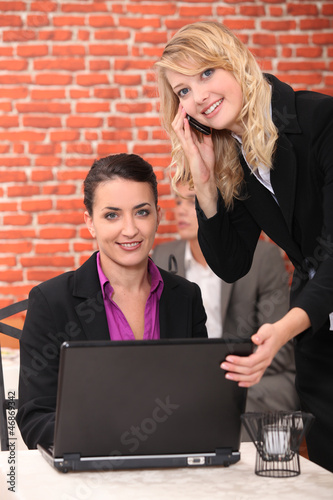 Women reading emails on laptop