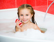 girl in the bath with a soap