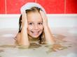 Little girl is taking a bath