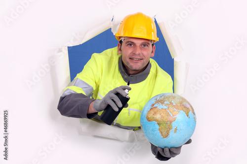 Man with aerosol and globe