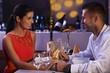 Elegant couple having dinner