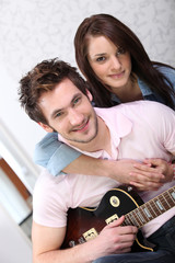 Man and woman with guitar