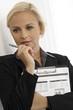Blonde businesswoman thinking
