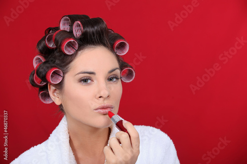 Woman beautifying herself