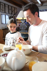 father and daughter having breakfast together