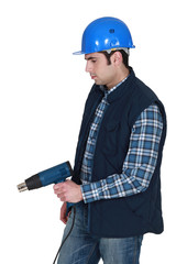Tradesman with a heatgun