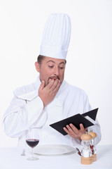 Restaurant worker looking through accounts
