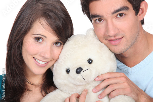 Young man and woman with a teddy bear