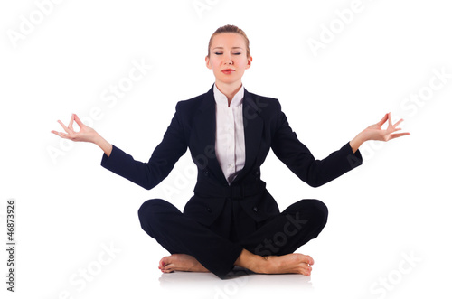 Young businesswoman meditating on the white