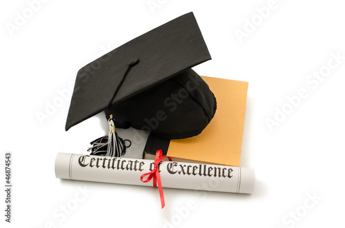 Grad hat and diploma with book isolated on white
