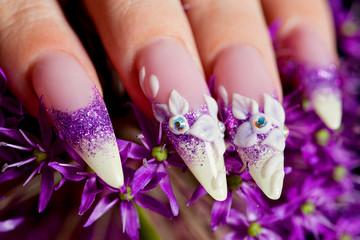 Close-up of female beautifully manicured nails