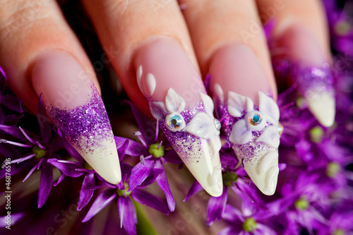 Close-up of female beautifully manicured nails