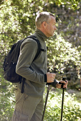 A mature man walking outdoors