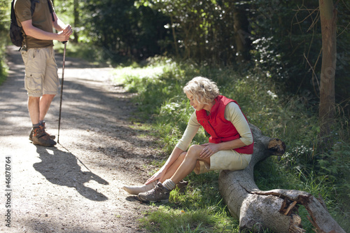 A mature couple resting beside a country path