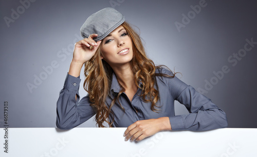 Autumn woman with publicity board