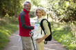 A mature couple standing on a country path smiling, close up