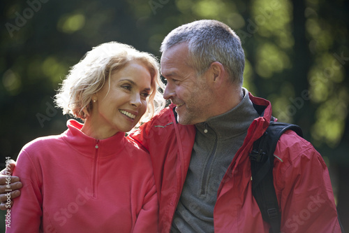 A mature couple outdoors, looking affectionately at each other