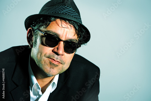 man with hat and sunglasses