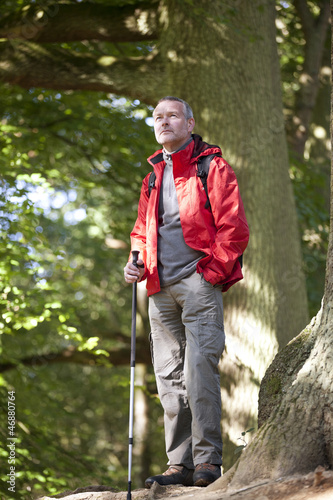 A mature man standing in the countryside