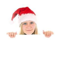 Mädchen mit Nikolausmütze hält weisse Tafel