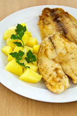 Fried fish with boiled potatoes