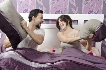 Pillow fighters in Bedroom