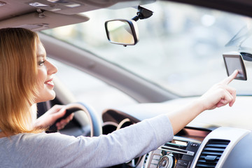 Young woman using GPS