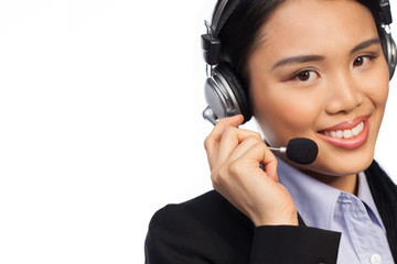 Smiling Asian woman wearing a headset