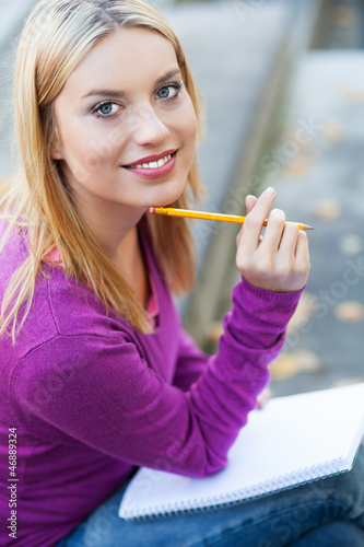 Student with notebook and pencil