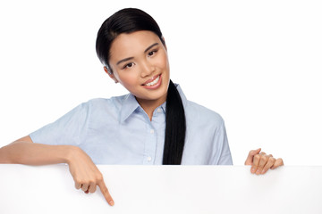 Asian businesswoman pointing to a signboard
