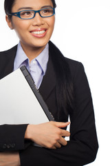 Asian businesswoman holding a laptop