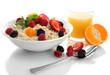 tasty oatmeal with berries and glass of juice, isolated on
