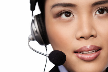 Closeup of an Asian lady wearing a headset