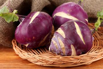 Fresh turnip on wooden background