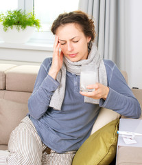 Ill Woman Taking Aspirin Pills.Headache
