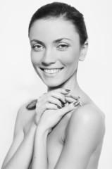 Closeup clean natural portrait of beautiful model smiling isolat