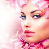 Fototapety Beautiful Girl With Orchid Flowers. Beauty Woman Face