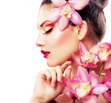 Fototapety Beauty Portrait. Beautiful Stylish Girl with Orchid Flower