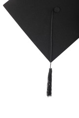 Graduation cap with black tassel on the white isolated