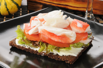 Crab and tomato with pumpernickel bread