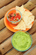 Guacamole dip with chips and salsa