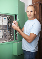 Man rewrites electric power meter readings