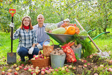 Happy couple with  harvested vegetables